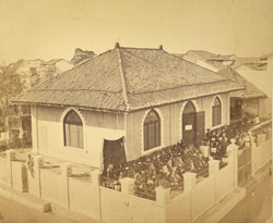 General view of Girls' School, Surat, with pupils gathered in yard in front of building